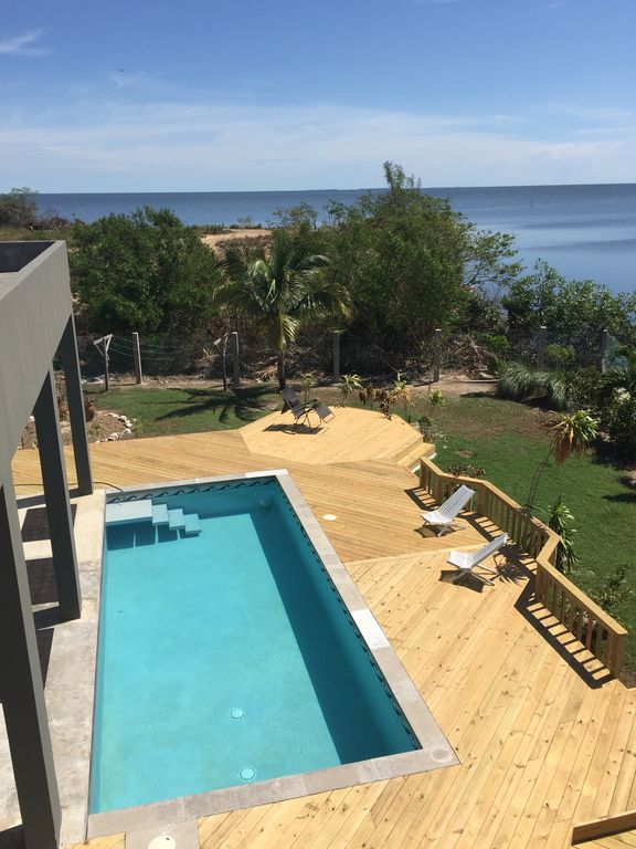 Waterfront Home W/ Pool and discount van rental to explore Mainland Sites
