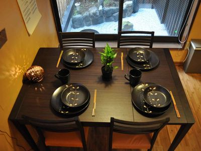 Kyoto property rental - Stylish Table, chairs, and dishes with view of zen garden (Bamboo Suite).