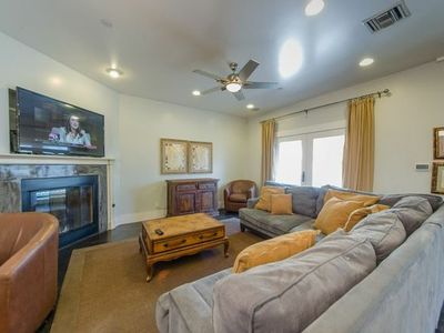 Comfortable living room with 55' 3D LED TV, fireplace and balcony