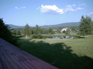 Stowe house photo - Summer view to trout pond from front deck