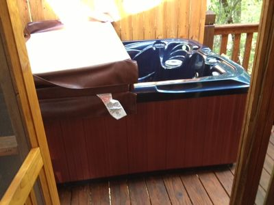 Brand new 3 person hot tub with two loungers and center seat.