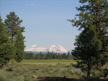 Bend house rental - View of the Sisters from the front deck .