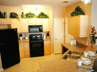 Terrace Ridge condo photo - Fully furnished kitchen with breakfast bar