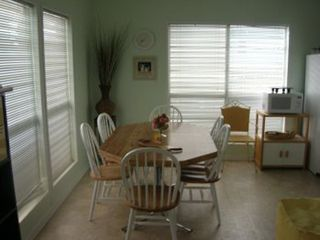 Sea Isle house photo - comfortable seating for 10 plus, two tables ready for dining and large kitchen
