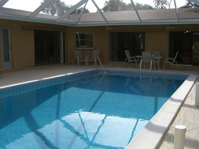 heated pool, opens to living room, family room and master bd and hall bath.