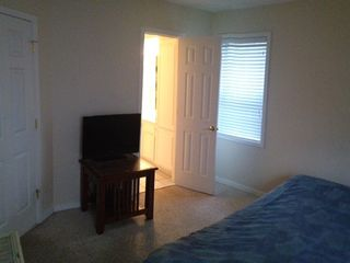 master bedroom- downstairs, flat screen TV and bathroom