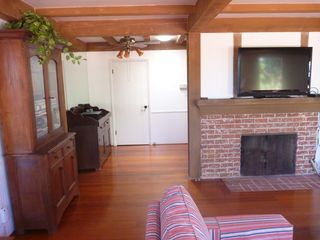 La Jolla house photo - Flatscreen TV, gas fireplace, hardwood floors, and extra closet.