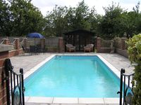2 bed bungalows with heated swimming pool in quiet village location