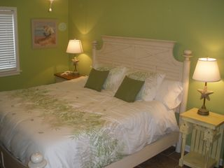 St. Simons Island condo photo - The master has a king size bed with memory foam mattress.