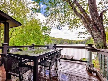 Lake Arrowhead house rental - View of lake from the deck. Deck has glass balusters, table/chairs, and a grill.