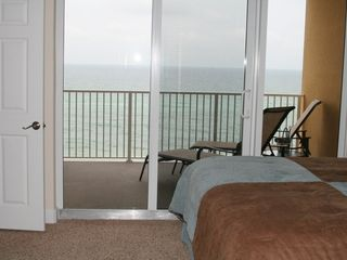 Tropic Winds condo photo - Master Suite -- wake up to the Dolphins swimming past you