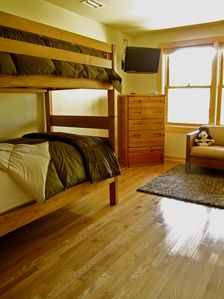 Watauga Lake cabin rental - Lower-level bedroom with four twins (bunked) and private bath.
