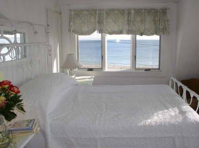 master bedroom has a large deck and views several miles down the beach
