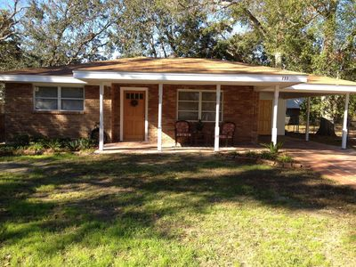 Nestled among beautiful mature live oaks, just a very short walk to the beach!