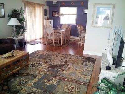 Entry into home view. New Pergo flooring, furniture, HDTV. Comfortable and roomy