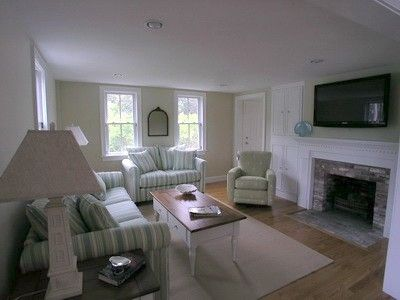 Spacious living room with fire place and large flat screen TV