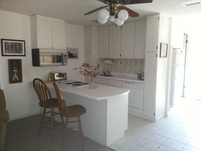 Full Kitchen with dishwasher, stove top, small oven/microwave, lots of light