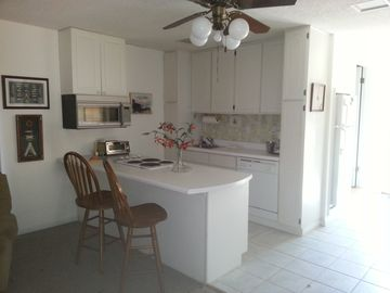 Niceville cabin rental - Full Kitchen with dishwasher, stove top, small oven/microwave, lots of light
