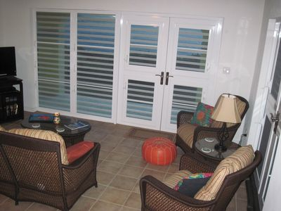 Water Island condo rental - Living Room Opens to Oceanfront Lanai