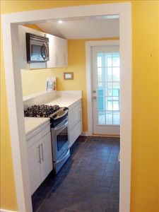 Recently renovated kitchen with gas stove and stainless steel appliances