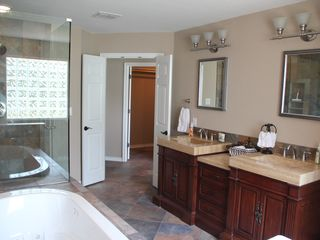 Canyon Lake house photo - Master bath with double vanity, whirlpool tub and spa shower system.