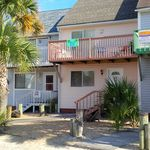 Beach Bum-Townhouse is located about 50 steps from the beach and fishing pier