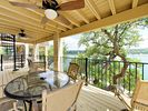 Deck - Covered deck with outdoor dining, ample seating, and stunning Lake Travis views.