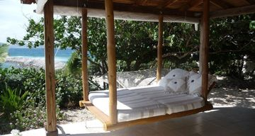 Chillax on the swinging bed in the Cabana while watching the Waves