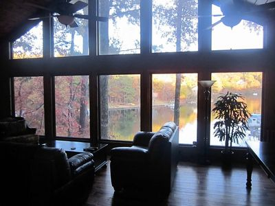 Great room with vaulted ceiling and 3 fans, view of lake in the fall.