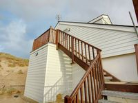 Brightly decorated beach home in the dunes