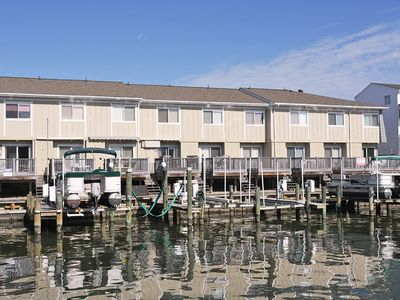 Fun, Colorful 2 Bedroom Unit with Free WiFi, an Outdoor Pool, and a Boat Lift Located Right on the Bay Side Canal Downtown Near Boardwalk Only 3 Blocks to Beach!