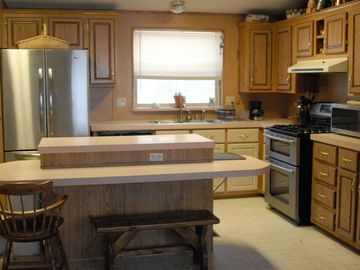 Kitchen with island and new appliances