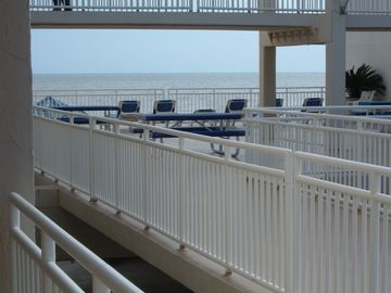 VIEW OF GULF FACEING COMMUNITY BALCONY, FROM OUR UNITS BALCONY