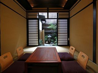 Enjoy a view of the tsuboniwa garden while relaxing in the living room. - Kyoto townhome vacation rental photo