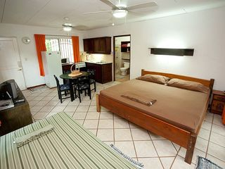 Tamarindo studio photo - The 'Orange' cabina has a King-size bed and a single bed.