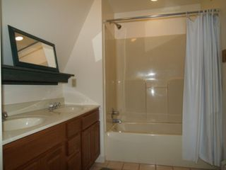 Onekama condo photo - Second floor bath with dual sinks, bath/shower combo, private commode