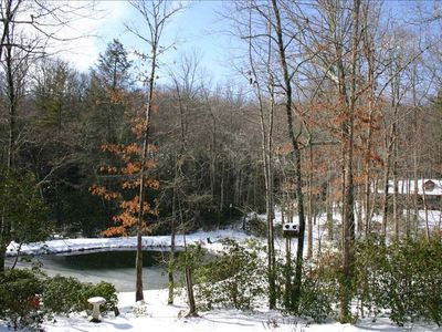 Panorama of pond and cabin in winter