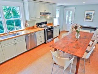Vineyard Haven house photo - Recently Renovated Kitchen Makes Indoor Entertaining Easy With Relaxed Family Seating At Oversized Antique Table