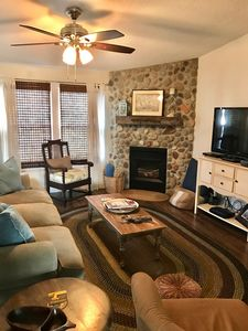 Comfortable living room with smart tv, queen sleeper and gas fireplace!