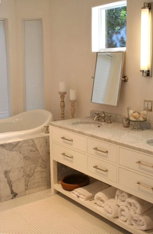 Large master bathroom with Jacuzzi tub, LCD TV, panoramic views of garden