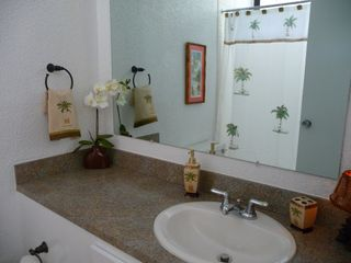 Southside condo photo - Nicely appointed bathrooms with tub/shower and vanities