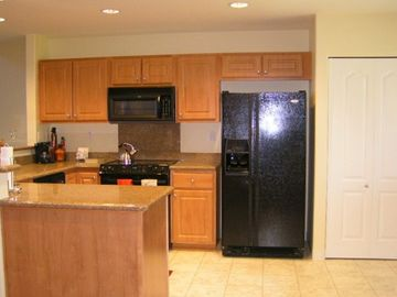 Large kitchen with granite counters and top of the line appliances