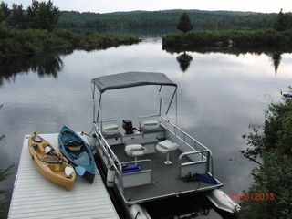 Colton cottage photo - pontoon boat and canoes