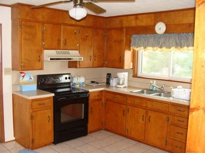 Spacious kitchen overlooks the lake