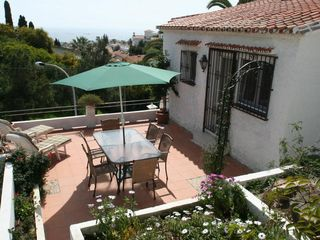 Caleta de Velez villa photo - East side. Terrace. Gardens and Sea views.