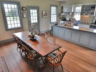 Edgartown house photo - Large Sun-Filled Country Kitchen Features Trestle Table for Family Gatherings & Easy Access To Cobblestone Patio For Outdoor Entertaining