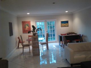 North Miami house photo - Family room with table seats 4, also 3 sofas, desk, game table & 5 extra chairs