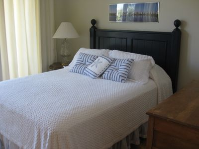 Guest bedroom with queen sized bed. This room has Lake Carillon views to north.