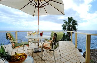 Honolulu house photo - Enjoy breakfast on the lanai right off the kitchen