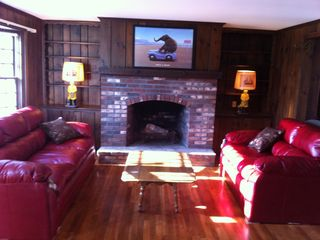 Yarmouth house photo - Cozy fireplaced living room w/new cranberry leather seating